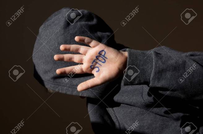 Abused teen with stop hand jesture